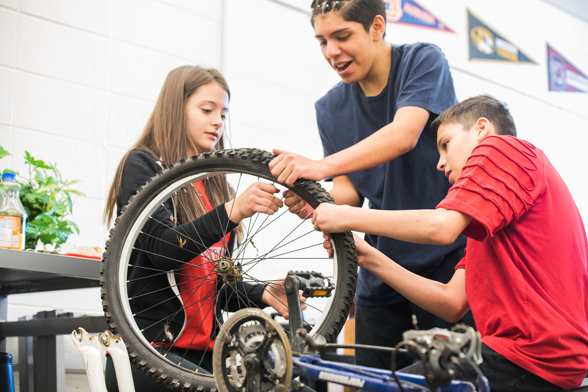 students working on a bike